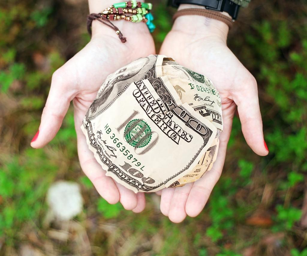 Image source: https://www.pexels.com/photo/cash-dollars-hands-money-271168/